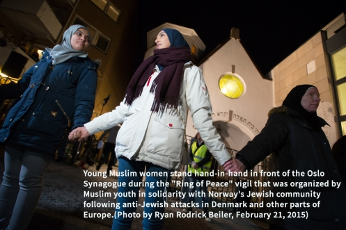 """Young Muslim women stand hand-in-hand in front of the Oslo Synagogue during the """"Ring of Peace"""" vigil, February 21, 2015. The vigil was organized by Muslim youth in solidarity with Norway's Jewish community following anti-Jewish attacks in Denmark and other parts of Europe."""