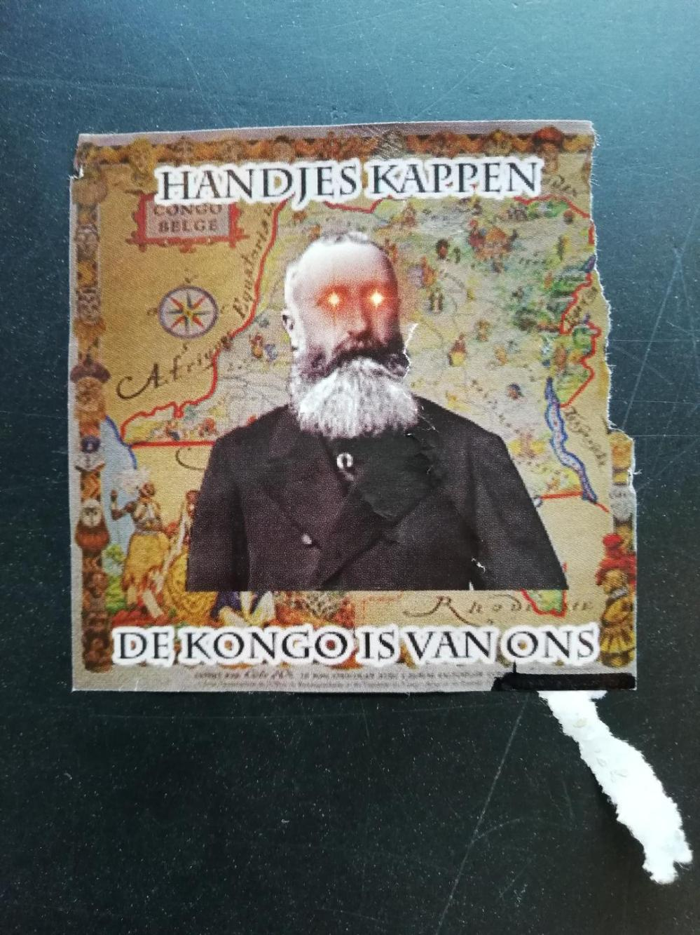 Handjes kappen de Congo is van ons (sticker in SJC)